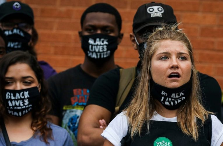 Workers speak out against Black Lives Matter face mask bans, as companies like Starbucks, Taco Bell, and Whole Foods grapple with viral backlash