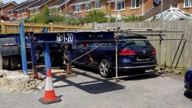 Man builds scaffold around neighbor's car in parking dispute