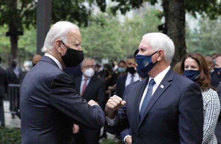 Joe Biden and Mike Pence meet and elbow bump at 9/11 Memorial at Ground Zero in New York City, reflecting coronavirus concern