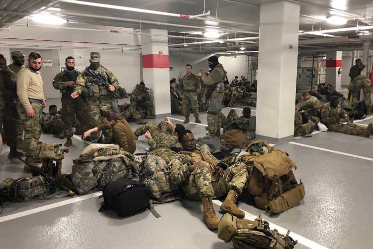 Lawmakers Fume After National Guard Troops Booted from Capitol to Sleep in Garage