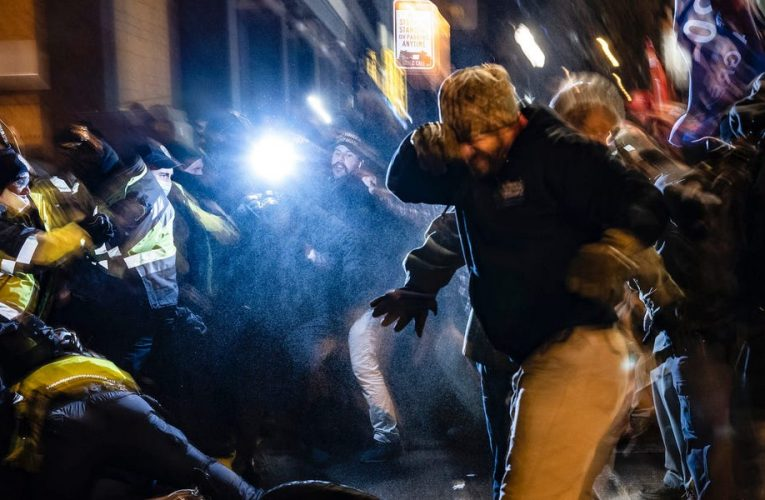 Video shows Trump supporters brawling with police ahead of Congress vote to certify Biden's win