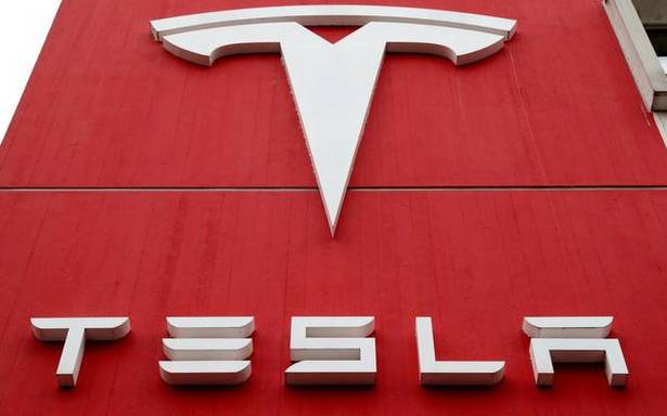 Tesla reports higher profits, says expansion on track