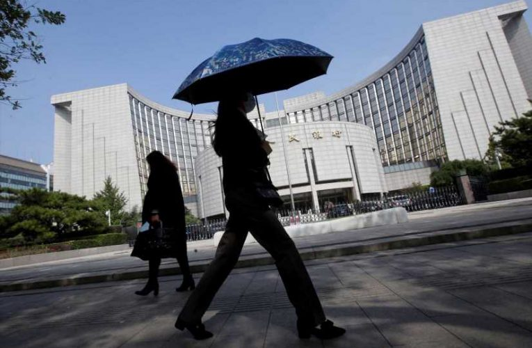 China's central bank warns of a swath of financial risks, including potential defaults