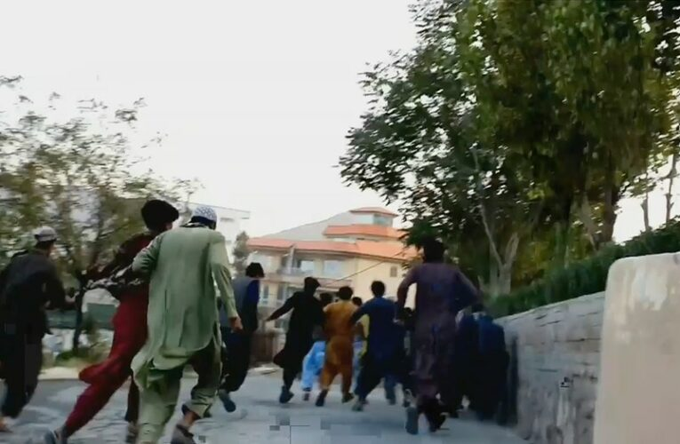 Taliban opens fire on protesters waving Afghan national flag in frightening video