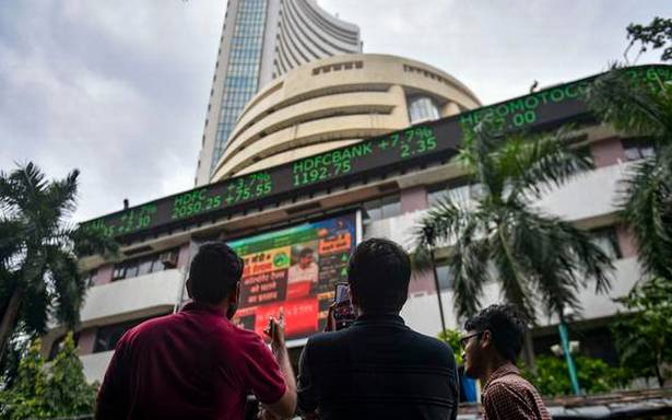 Sensex, Nifty scale new peaks; TCS tanks over 6%